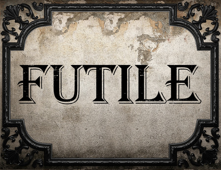 futile: futile word on concrette wall Stock Photo