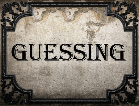 and guessing: guessing word on concrette wall Stock Photo