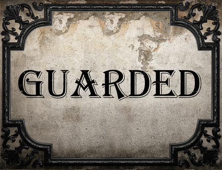 guarded: guarded word on concrette wall Stock Photo