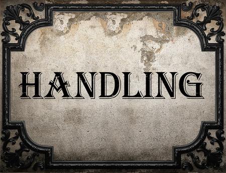 handling: handling word on concrette wall