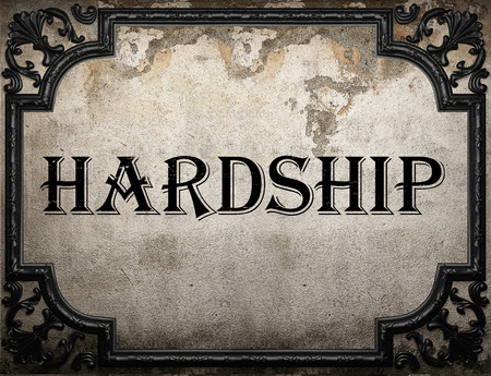 hardship: hardship word on concrette wall