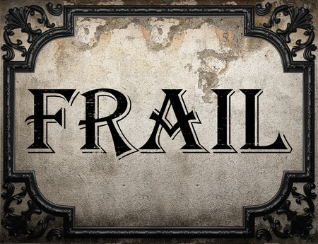 frail: frail word on concrette wall Stock Photo