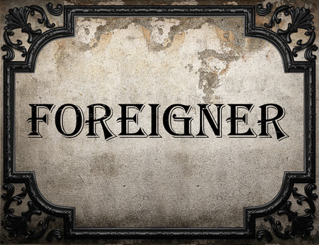 foreigner: foreigner word on concrette wall Stock Photo