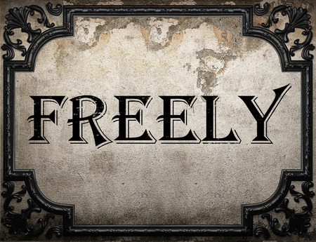 freely: freely word on concrette wall
