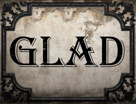 glad: glad word on concrette wall