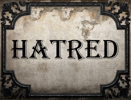 hatred: hatred word on concrette wall