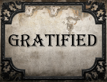 gratified: gratified word on concrette wall
