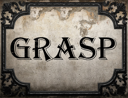 grasp: grasp word on concrette wall