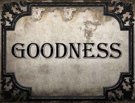 goodness: goodness word on concrette wall