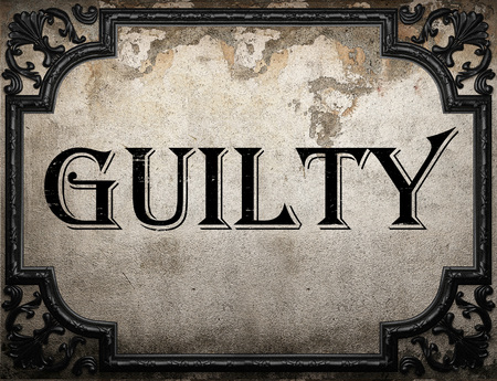 guilty: guilty word on concrette wall
