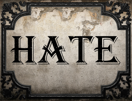 hate: hate word on concrette wall