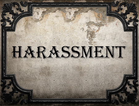 harassment: harassment word on concrette wall