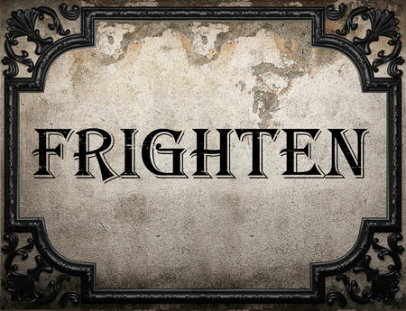 frighten: frighten word on concrette wall
