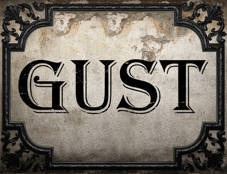 gust: gust word on concrette wall