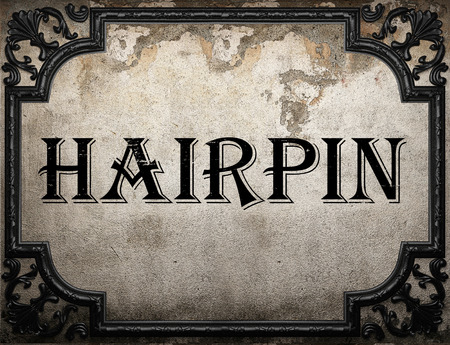hairpin: hairpin word on concrette wall