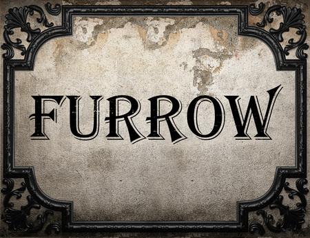 furrow: furrow word on concrette wall
