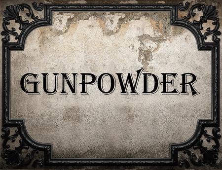 gunpowder: gunpowder word on concrette wall