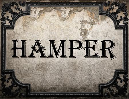hamper: hamper word on concrette wall