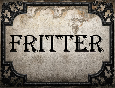 fritter: fritter word on concrette wall Stock Photo