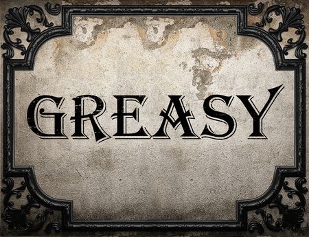 greasy: greasy word on concrette wall