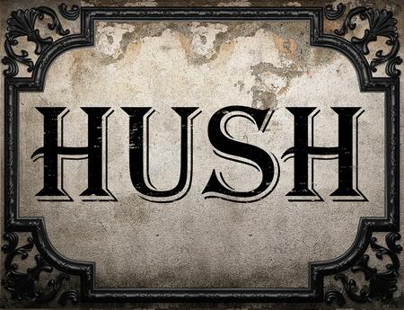 hush hush: hush word on concrette wall