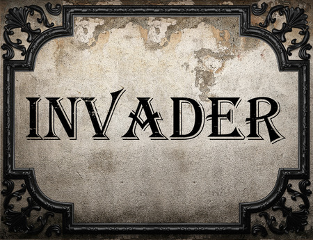 invader: invader word on concrette wall Stock Photo