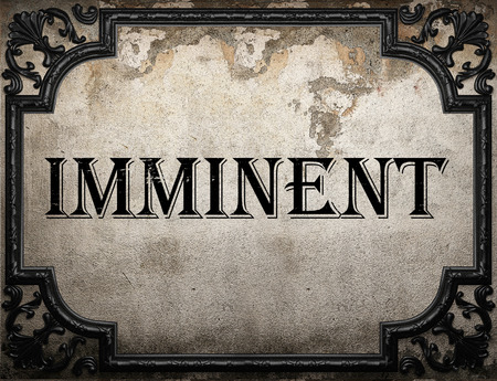 imminent: imminent word on concrette wall Stock Photo