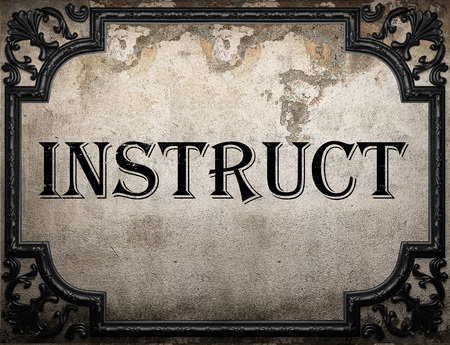instruct: instruct word on concrette wall Stock Photo