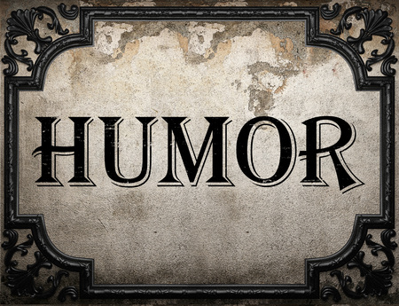 humor: humor word on concrette wall Stock Photo
