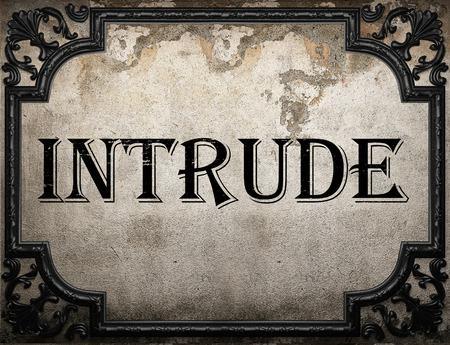 intrude: intrude word on concrette wall Stock Photo