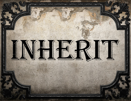 inherit: inherit word on concrette wall