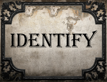 identify: identify word on concrette wall Stock Photo