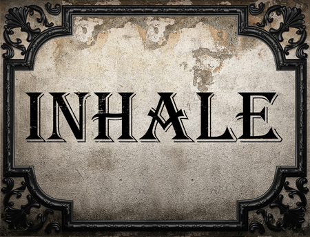 to inhale: inhale word on concrette wall