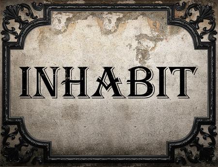 inhabit: inhabit word on concrette wall