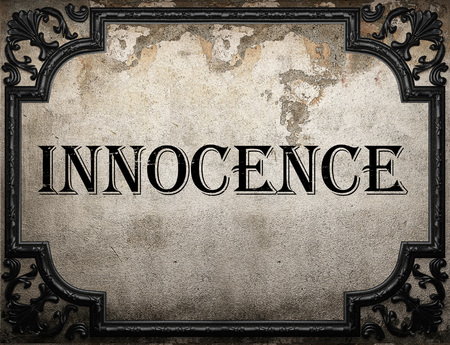the innocence: innocence word on concrette wall Stock Photo