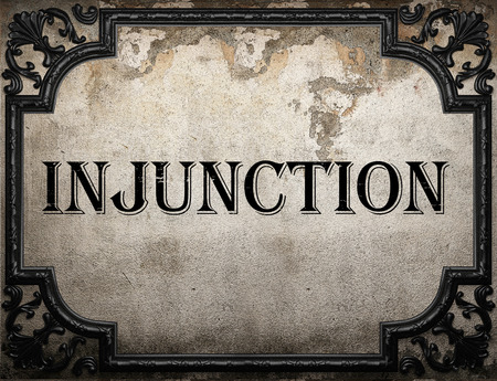 injunction: injunction word on concrette wall