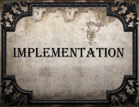 implementation: implementation word on concrette wall Stock Photo