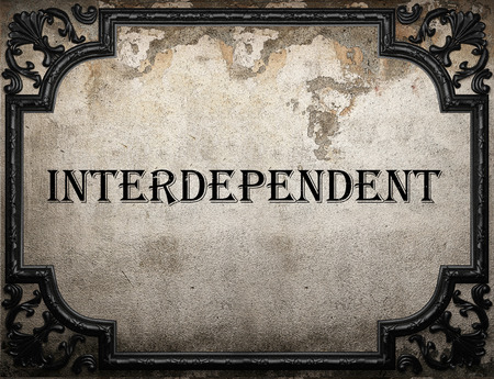 interdependent: interdependent word on concrette wall Stock Photo