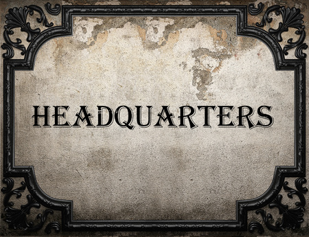 headquarters: headquarters word on concrette wall Stock Photo