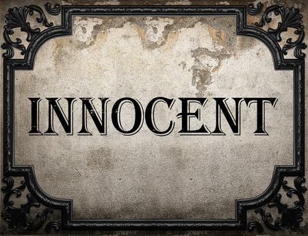 innocent: innocent word on concrette wall Stock Photo