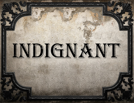 indignant: indignant word on concrette wall