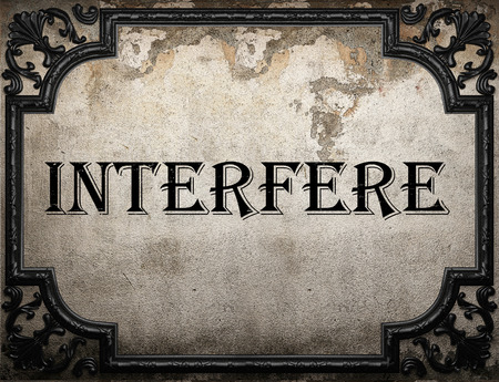 to interfere: interfere word on concrette wall Stock Photo