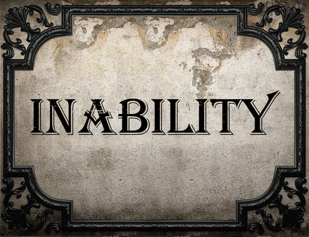inability: inability word on concrette wall