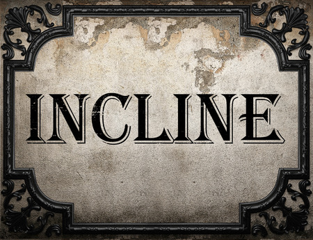 incline: incline word on concrette wall Stock Photo