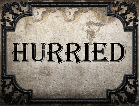 hurried: hurried word on concrette wall