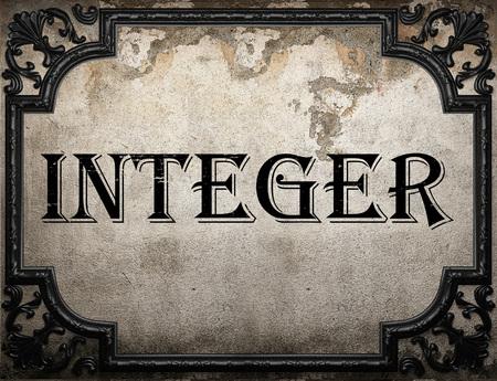 integer: integer word on concrette wall Stock Photo
