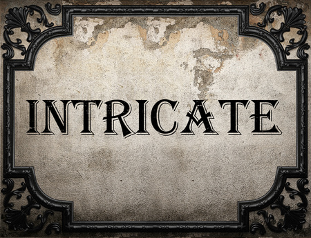 intricate: intricate word on concrette wall