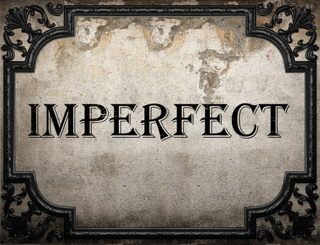imperfect: imperfect word on concrette wall Stock Photo