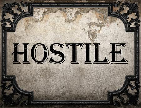 hostile: hostile word on concrette wall