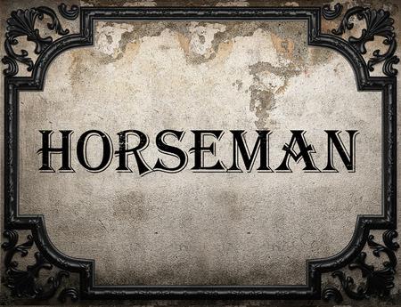 uomo a cavallo: parola di cavaliere sulla parete concrette Archivio Fotografico
